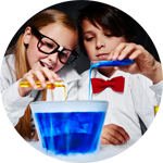 boy and girl pouring chemicals into an experiment